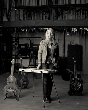 Cindy surrounded by her guitars in Gruven Stands